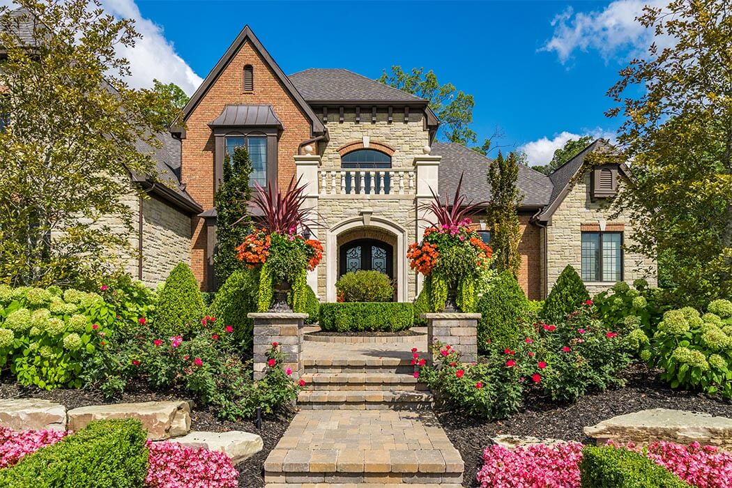 Estate Home Exterior with colorful gardens