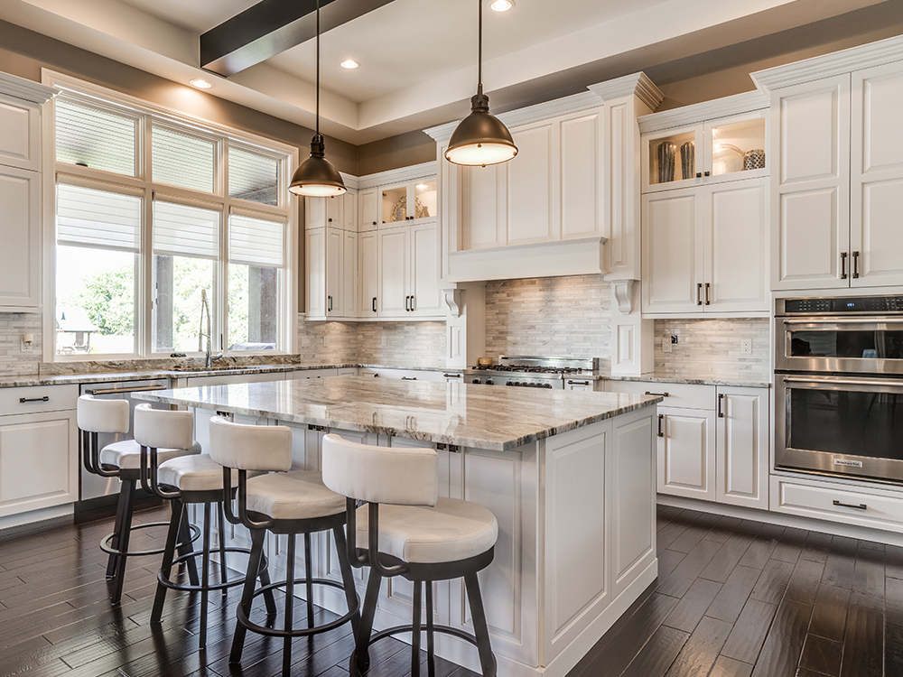White kitchen with large island